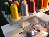 Embroidery machine thread rack
